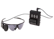 Glasses, a video processing unit (VPU) and a cable are part of the Argus II System